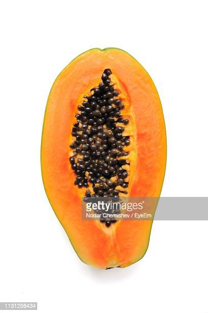 cross section of papaya against white background - papaya stock photos and pictures