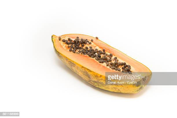 Cross Section Of Papaya Against White Background