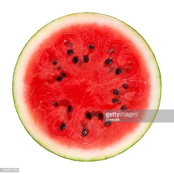 Cross section of ripe watermelon with black seeds