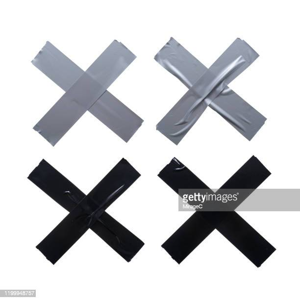 cross shape duct tape stripes - adhesive tape stock pictures, royalty-free photos & images