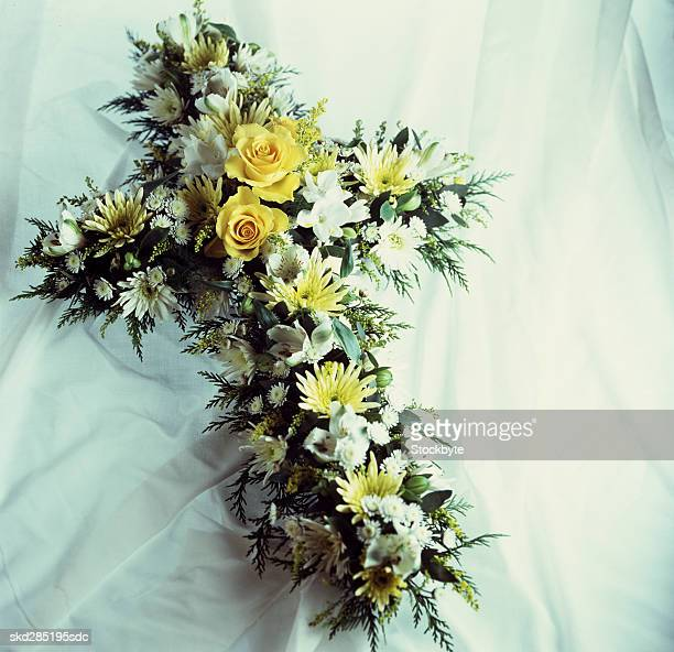 cross shaped bouquet - crosses with flowers stock pictures, royalty-free photos & images