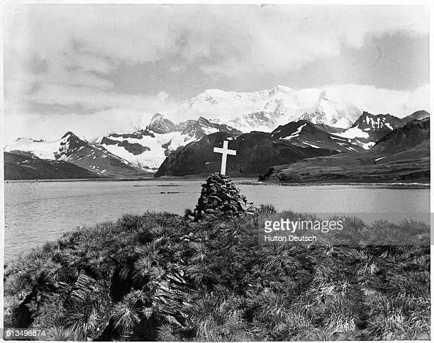 Cross tops a stone cairn at the grave site of Ernest Shackleton, who died of heart failure during the Shackleton-Rowett Antarctic Expedition in...