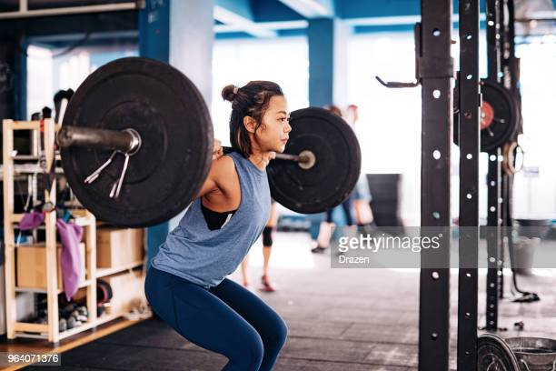 cross training and weight lifting - circuit training stock photos and pictures