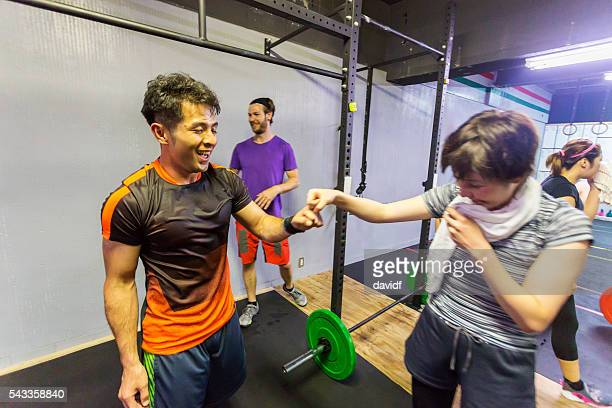 Cross Training Athletes Congratulate Each Other After an Exercise Workout