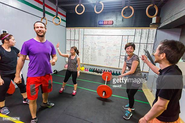 cross training athletes congratulate each other after an exercise workout - circuit training stock photos and pictures