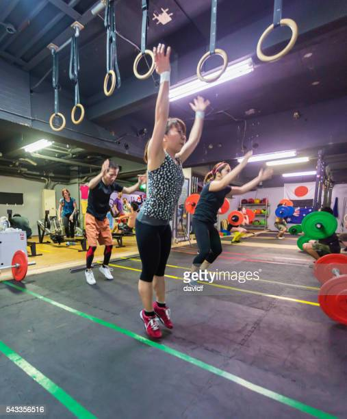 cross training athletes during an exercise workout - circuit training stock photos and pictures