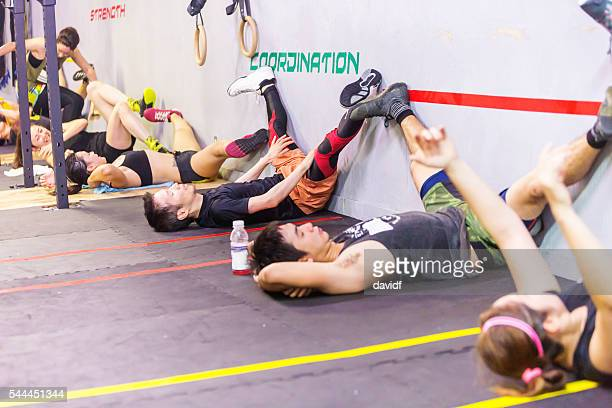 cross training athletes stretch before an exercise workout - circuit training stock photos and pictures