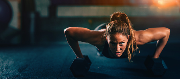 Cross training fitness. Young woman exercising 953448894