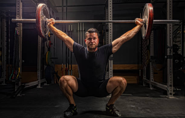 cross training - men at gym stock pictures, royalty-free photos & images