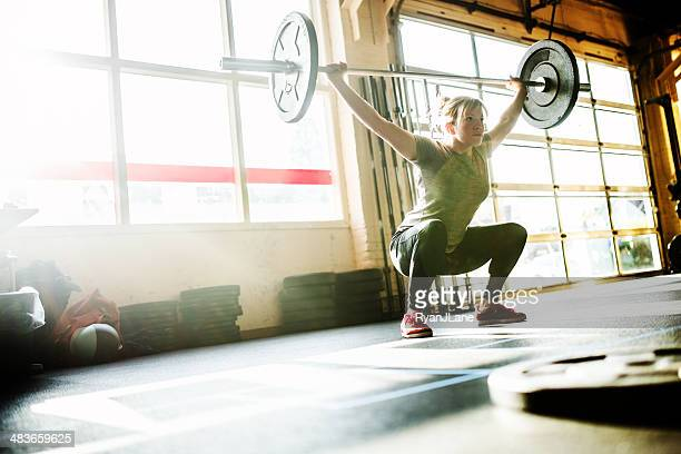 cross training woman - snatch weightlifting stock photos and pictures