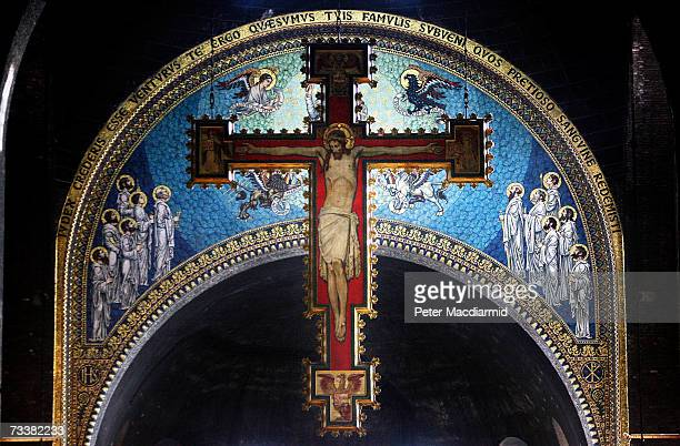 A cross with a painting of Jesus Christ hangs over the alter at Westminster Cathedral during Ash Wednesday mass on February 21 2007 in London During...