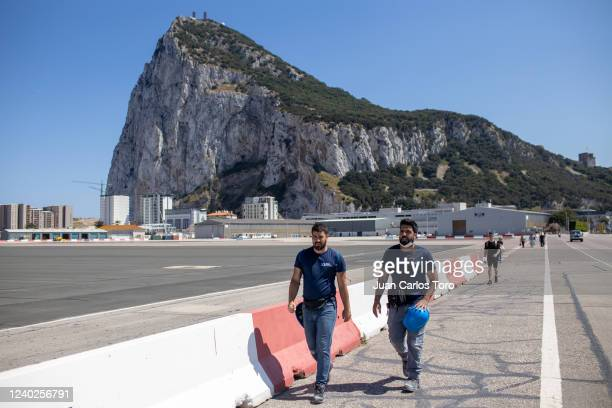 Cross-border workers walk to exit the rock on June 01, 2020 in Gibraltar. The only Spanish people allowed to enter Gibraltar were cross frontier...