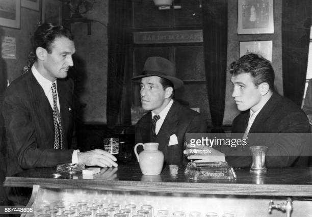 Crosscounter view of Eddie Chapman Billy Hill and George Walker discussing the mystery of the Flamingo in London yesterday 1st August 1954