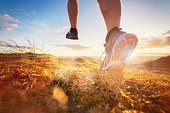Cross-country running in early morning sunrise