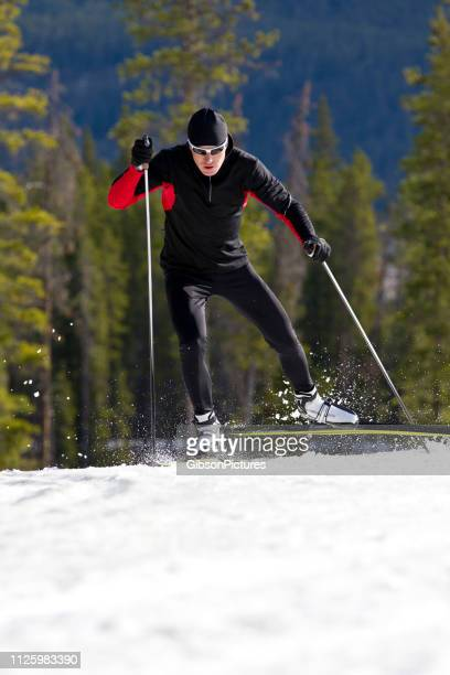cross-country skate ski man - ski pole stock pictures, royalty-free photos & images