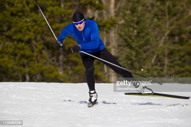 cross-country skate ski man - cross country skiing stock pictures, royalty-free photos & images