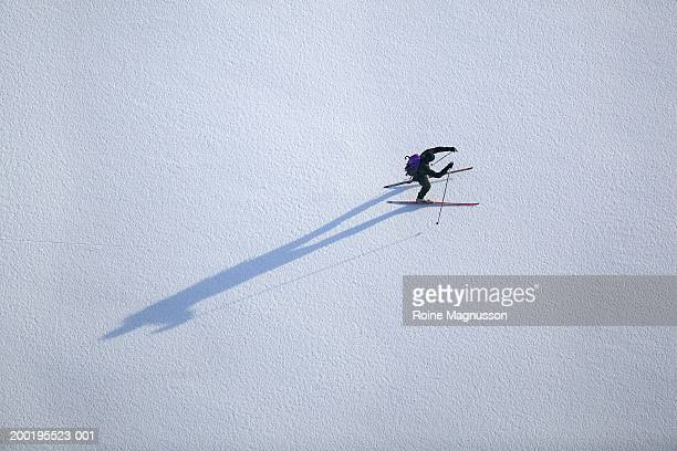 cross-country skier on frozen lake, aerial view - cross country skiing stock pictures, royalty-free photos & images