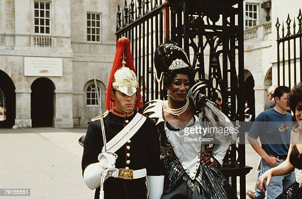 A crossdresser having her picture taken with a member of the Household Cavalry at Buckingham Palace during Lesbian and Gay Pride London 24th June 1995