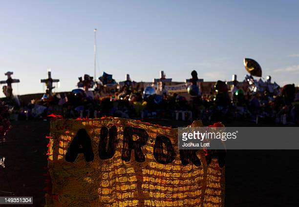 Crosses and a banner are lit by the morning light at a memorial across the street from the Century 16 movie theatre July 27 2012 in Aurora Colorado...