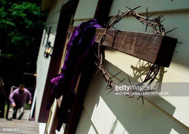 Crosses and a crown of thorns are seen before a Pentecostal serpent handlers service at the House of the Lord Jesus church in Squire West Virginia on...