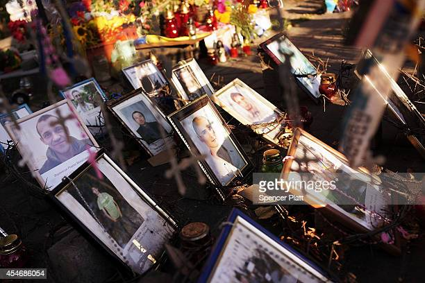 Crosses and pictures of Ukrainian protesters who were killed during demonstrations in Independence Square, or Maidan Square, are viewed on September...