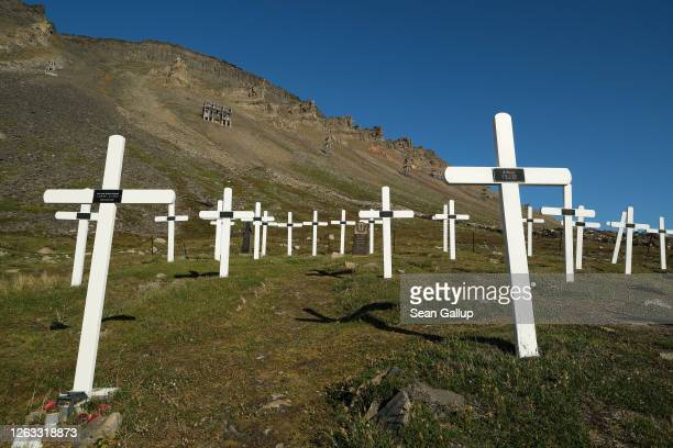 Crosses at the Longyearbyen cemetery which includes victims of the 1918 Spanish flu pandemic stand during a summer heat wave on Svalbard archipelago...