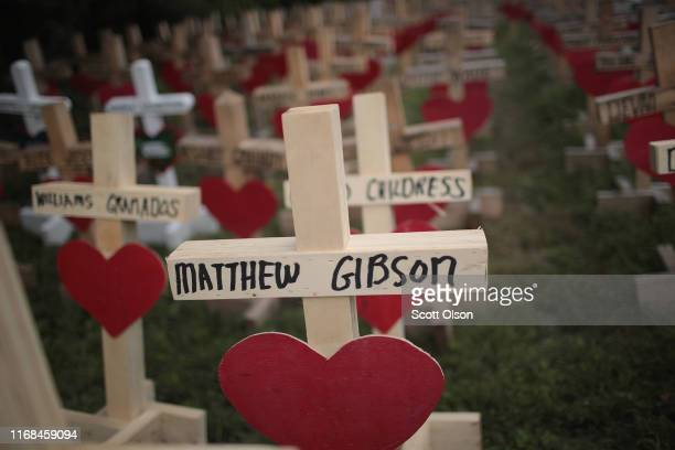 Crosses cover a vacant lot in the West Englewood neighborhood on August 16 2019 in Chicago Illinois The crosses are a memorial to the victims of the...