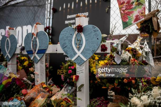 Crosses in memorial of those lost outside the site of a shooting at a King Soopers grocery store on Thursday, March 25, 2021 in Boulder, Colorado....