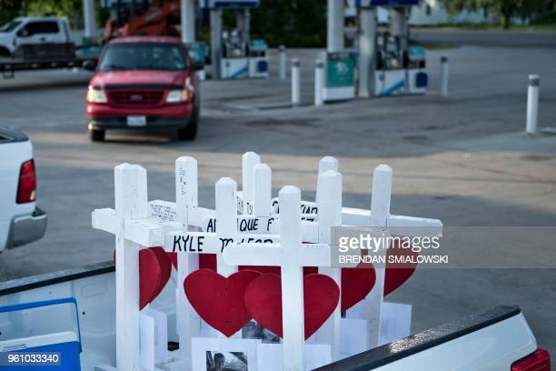 Crosses made by Greg Zanis for the victims of the Santa Fe High School shooting are seen in a pickup truck on his way to the high school on May 21...