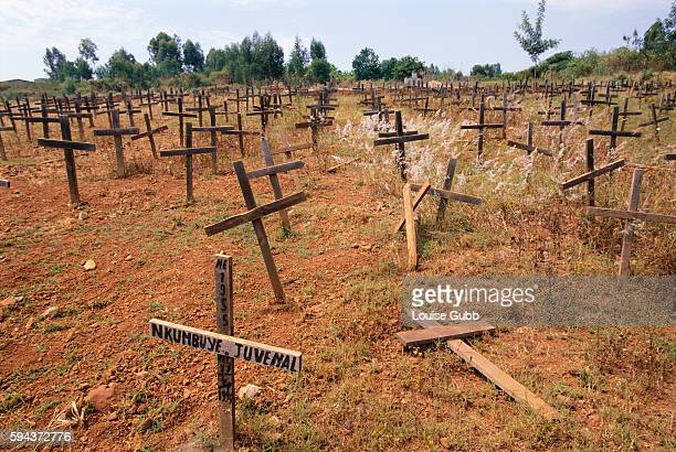 Crosses mark a mass grave site of the victims of the April 11, 1994 massacre of thousands of refugees at a technical institute in Kigali's Kicukiro...