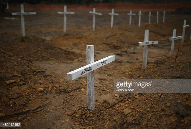 Crosses mark the graves of unknown infants buried in the USbuilt cemetery for safe burials on January 27 2015 in Disco Hill Liberia The cemetery...