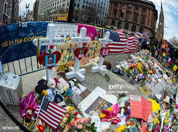 Crosses memorializing Boston Marathon bombing victims Martin Richard Lu Lingzi and Krystie Cambell at a memorial to all victims of the Boston...