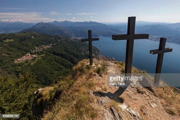 crosses on monte morissolo, view of trarego-viggiona and lago maggiore, verbano-cusio-ossola province, piedmont region, italy - province of verbano cusio ossola stock pictures, royalty-free photos & images