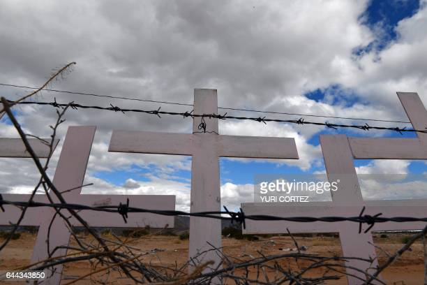 Crosses placed in memory of eight victims of feminicide which were found at Lomas del Poleo are pictured on February 19 2017 in Ciudad Juarez...