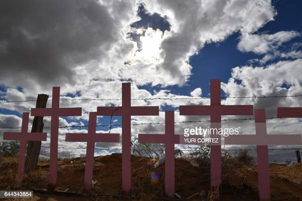 TOPSHOT Crosses placed in memory of eight victims of feminicide which were found at Lomas del Poleo are pictured on February 19 2017 in Ciudad Juarez...