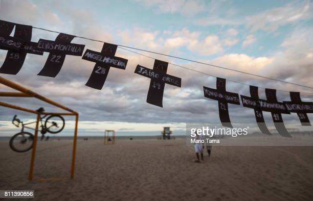 Crosses representing Venezuelans killed in antigovernment protests are displayed on Copacabana beach at a demonstration protesting the regime of...