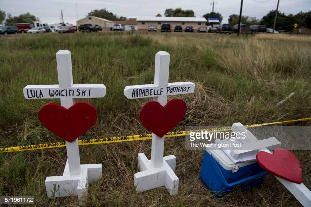 Crosses with hearts stand along the edge of a field next to Sutherland Springs First Baptist Church in honor of the shooting victims in Sutherland...
