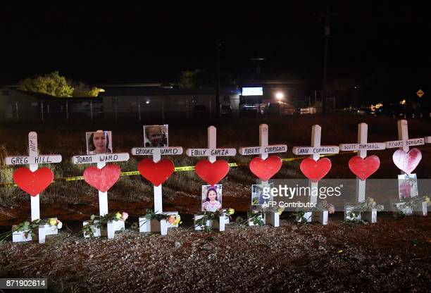 TOPSHOT Crosses with the names of victims are seen outside the First Baptist Church which was the scene of the mass shooting that killed 26 people in...