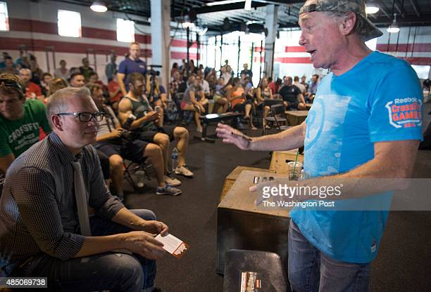 Crossfit Inc founder and CEO Greg Glassman talks to employees prior to a presentation at the Half street location in Washington DC on July 31 2015...