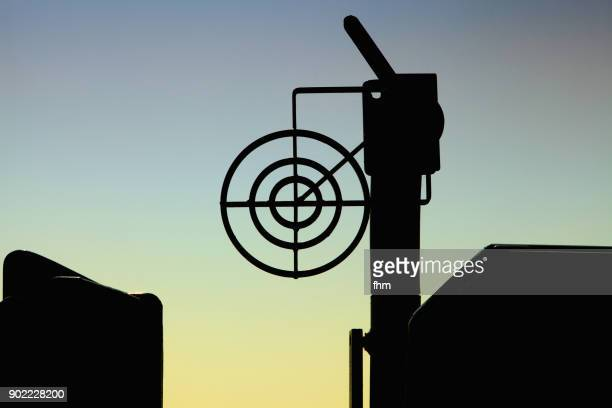 Crosshair and cannon silhouette