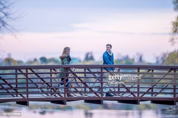 crossing a bridge - fatcamera stock pictures, royalty-free photos & images