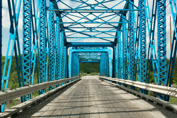 Crossing a rural truss bridge by car