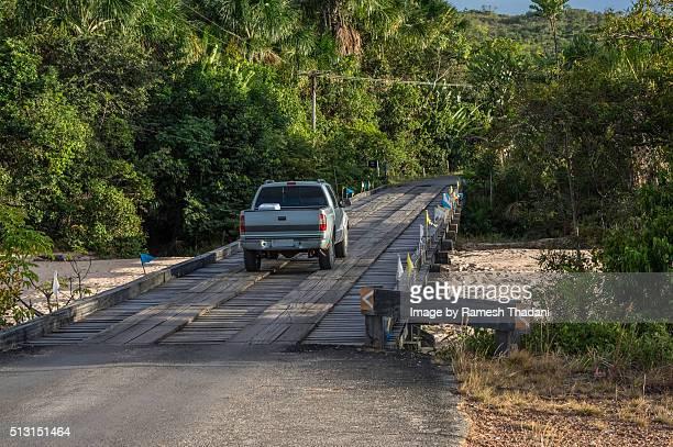 Crossing a wooden bridge