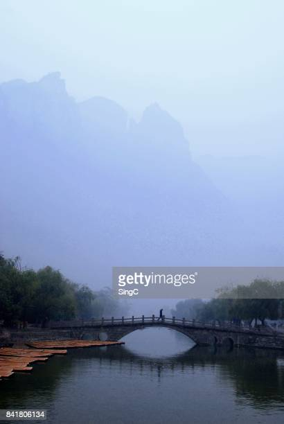 crossing ancient china bridge - henan province stock photos and pictures