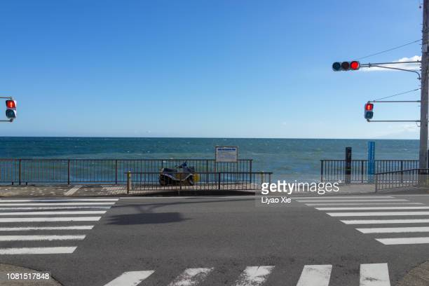 crossing at seaside - road signal stock pictures, royalty-free photos & images
