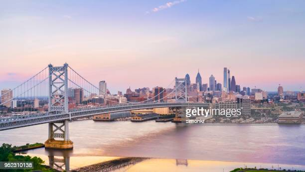 crossing benjamin franklin bridge from camden, nj to philadelphia, pa - philadelphia skyline stock pictures, royalty-free photos & images