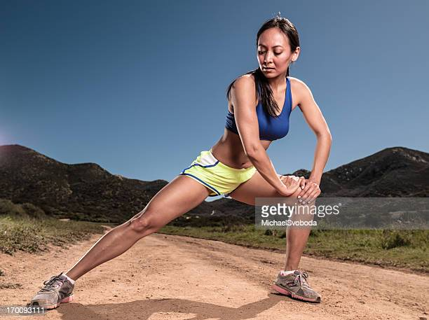 crossing country runner - beautiful asian legs stock photos and pictures