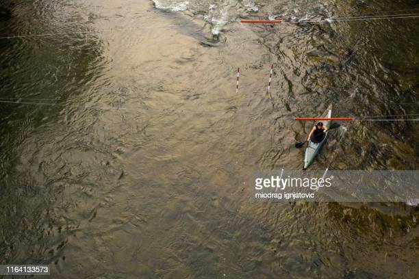 crossing gates on river in kayak from above - swift river stock photos and pictures