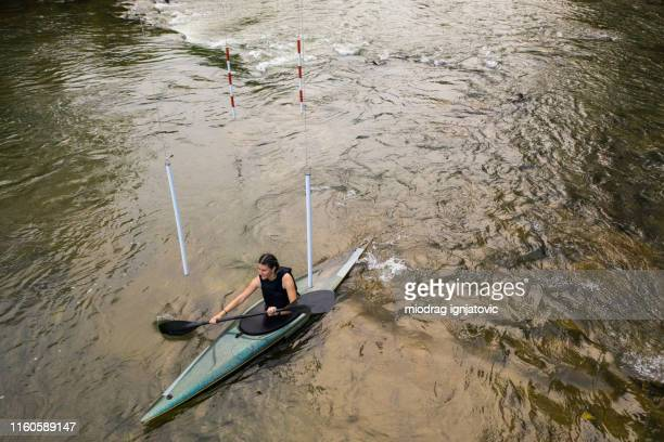 crossing gates on river in kayak - swift river stock photos and pictures