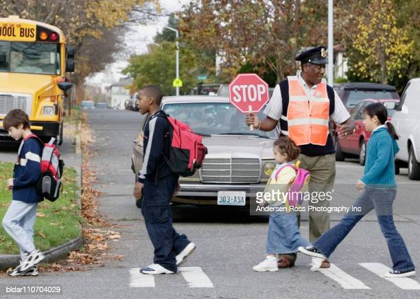 Crossing Guard Helping Kids Cross Safely